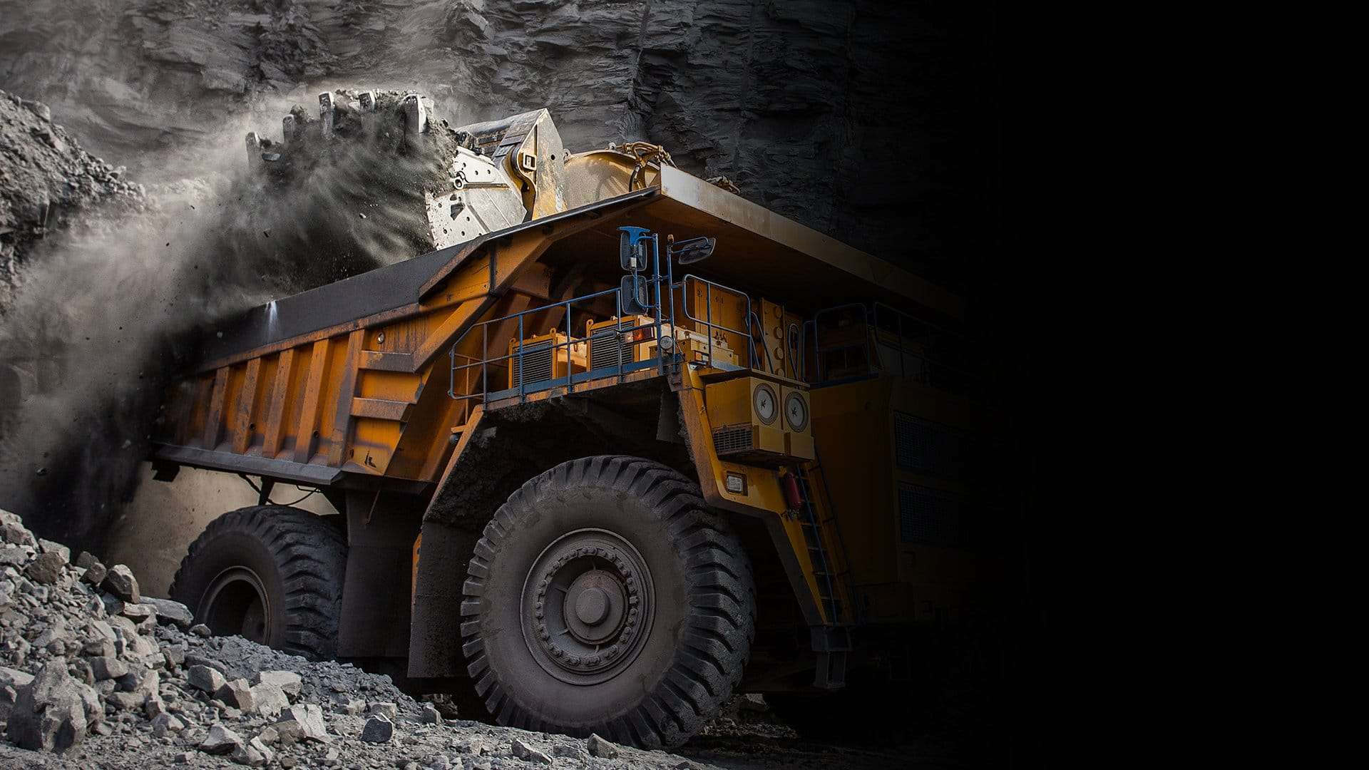 Mining vehicle hauling a heavy load, fire suppression systems