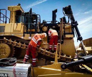 Technicians Installing Fire Suppression on Heavy Equipment