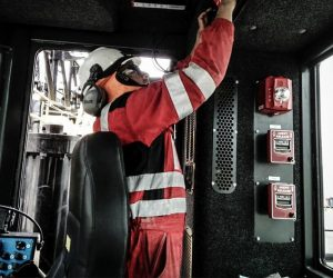 Heavy Equipment Operator Performing Fire Risk Assessment to Select Best Fire Suppression System